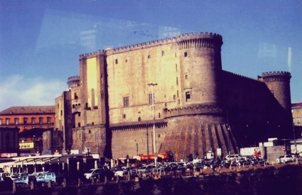 12th century fortress is in the harbour of Naples, Italy