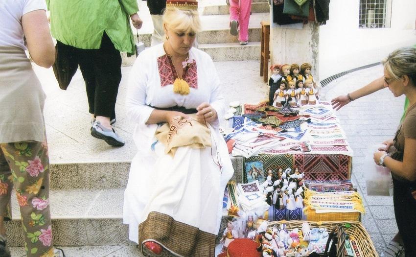 Woman doing needlework in Dubrovnik, Croatia