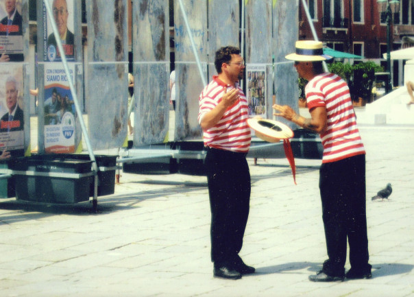 Two gondoliers argueing in Venice