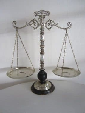 Scales of Justice is a symbol of law and the author served as the Multnomah County Deputy District Attorney in Portland, Oregon.