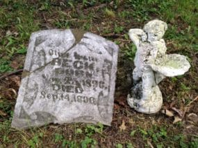 Novel explores issue of grief. Headstone and statue from historic cemetery, Sault Ste. Marie, Ontario, Canada.